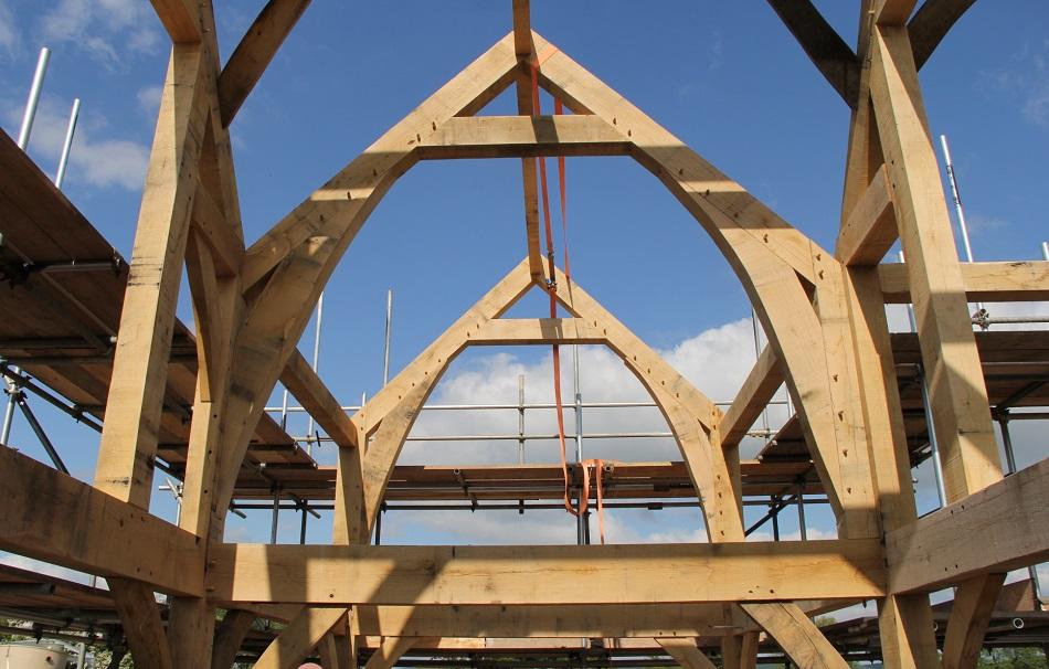 Curved sling braces oak frame